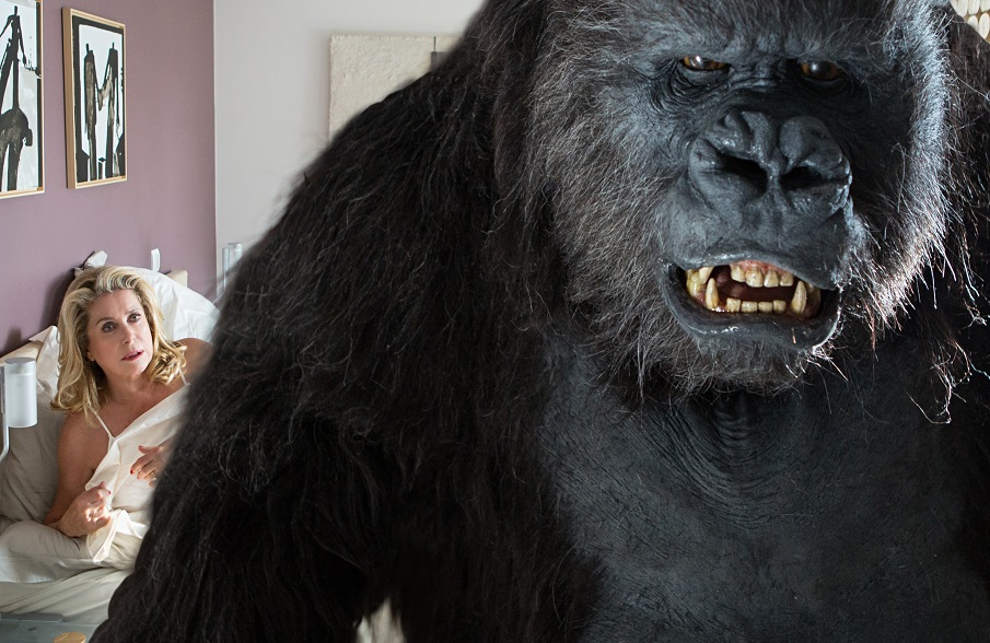Catherine Deneuve invites a gorilla into her boudoir in The Brand New Testament